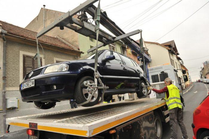 Se începe ridicarea mașinilor parcate neregulamentar în București. Costul, 500 de lei